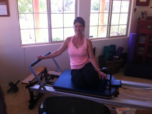Dawn seated on reformer